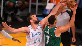 Marc Gasol #14 of the Los Angeles Lakers guards Dwight Powell #7 of the Dallas Mavericks at Staples Center on Dec. 25, 2020 in Los Angeles, California.