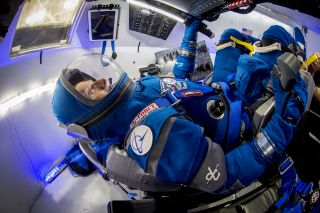"Former NASA astronaut Chris Ferguson tries on the ""Boeing Blue"" spacesuit, a private suit for astronauts flying on Boeing's new CST-100 Starliner space capsule. NASA will use Boeing's Starliner vehicles as private space taxis for American astronauts."