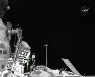 Astronauts Whack Golf Ball and Outfit Station in Spacewalk