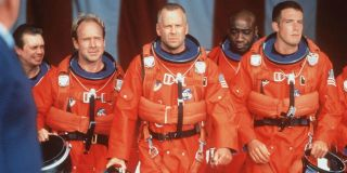 Rockhound, Chick, Stamper, Bear, and A.J. march toward their spaceship while wearing their space sui