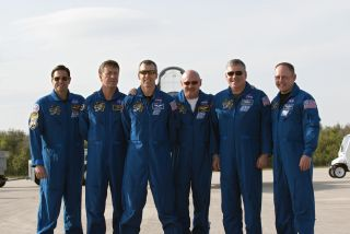 Space shuttle Endeavour's STS-134 crew members pose for a group photo on the Shuttle Landing Facility at NASA's Kennedy Space Center in Florida after arriving on March 29, 2011 to begin final launch training ahead of an April 19 liftoff.