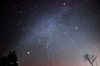 Geminid meteors shower downward on a December night in a remote part of Virginia.