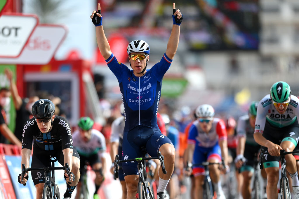 LA MANGA SPAIN AUGUST 21 Fabio Jakobsen of Netherlands and Team Deceuninck QuickStep celebrates winning ahead of Alberto Dainese of Italy and Team DSM during the 76th Tour of Spain 2021 Stage 8 a 1737 km stage from Santa Pola to La Manga del Mar Menor lavuelta LaVuelta21 on August 21 2021 in La Manga Spain Photo by Stuart FranklinGetty Images