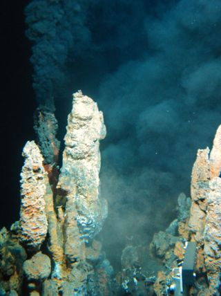 Black smoke rises vigorously at vents when the hot, chemically-altered seawater mixes with the cold, oxygenated bottom water. The hydrothermal alterations to seawater occurring at these relatively isolated locations affect the global ocean chemical budget