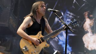 Guitarist Malcolm Young performing in Berlin, Germany, Olympiastadion