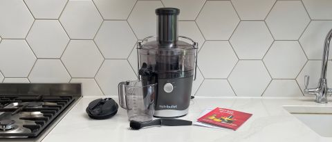 Nutribullet Juicer on a kitchen countertop surrounded by its accessories