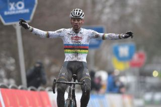 Dutch Mathieu Van Der Poel celebrates as he crosses the finish line to win the men elite race of the Flandriencross the sixth stage in the Trofee Veldrijden Cyclocross competition on January 23 2021 in Hamme Photo by DAVID STOCKMAN various sources AFP Belgium OUT Photo by DAVID STOCKMANBelgaAFP via Getty Images