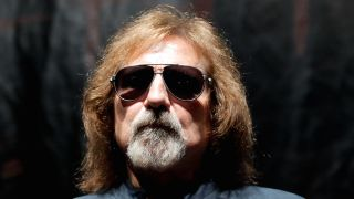 A close-up of Geezer Butler wearing sunglasses