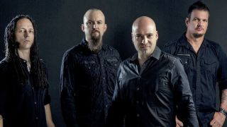 A promotional photo of Disturbed