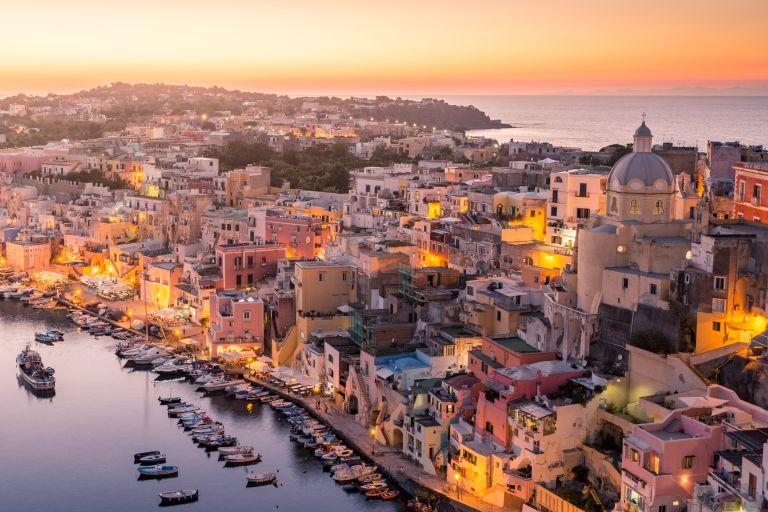 Procida Naples colorful island in the italian sea coast Sunset over La Corricella Harbour