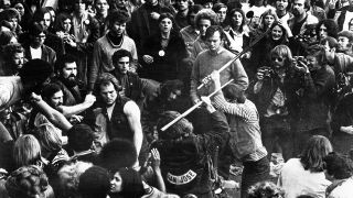 Hells Angels beat a fan with pool cues at the Altamont Free Concert