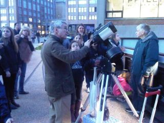Joe Delfausse, a member of the Amateur Astronomers Association of New York, helps a group of children observe the moon from New York City's High Line park.