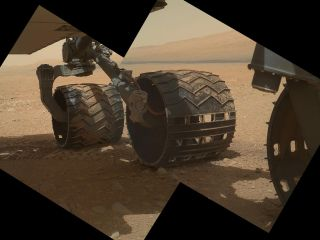 This view of the three left wheels of NASA's Mars rover Curiosity combines two images that were taken by the rover's Mars Hand Lens Imager.