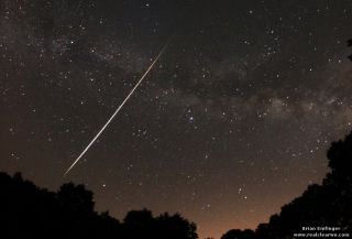 Skywatcher and photographer Brian Emfinger captured this magnificent Lyrid fireball with the Milky Way in the background from Ozark, Ark., during the April 21-22 peak of the 2012 Lyrid meteor shower.