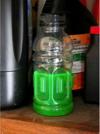 A bottle containing brightly colored antifreeze, which can look like an inviting treat to a young child.