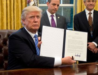 President Donald Trump signed an executive order withdrawing the U.S. from the Trans-Pacific Partnership on Jan. 23, 2017.