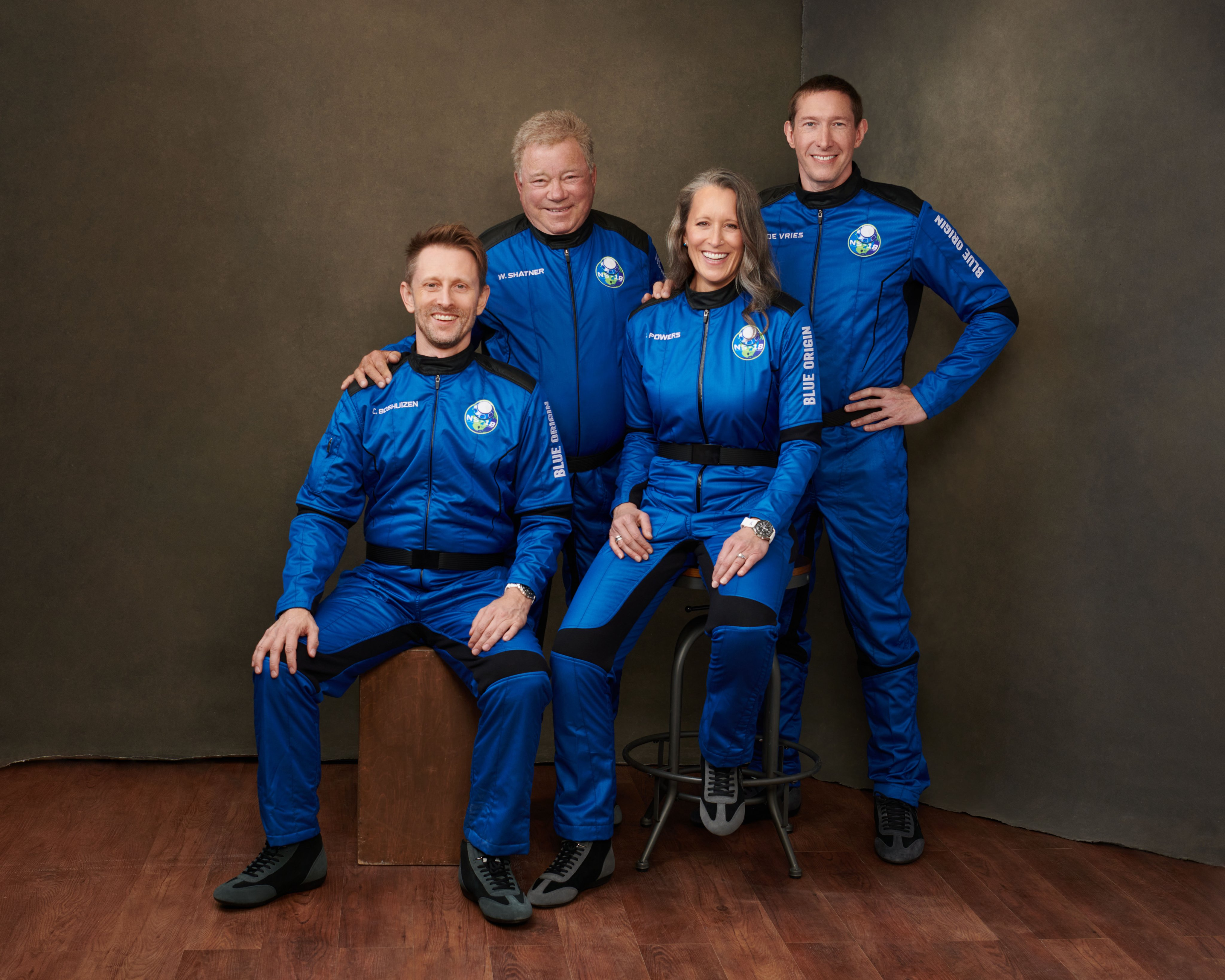 """An official crew portrait for the NS-18 mission shows, from left, Chris Boshuizen, co-founder of the Earth-observation company Planet; """"Star Trek"""" actor William Shatner; Blue Origin vice president Audrey Powers; and Glen de Vries, vice chair for life sciences and healthcare at the French software company Dassault Systèmes."""