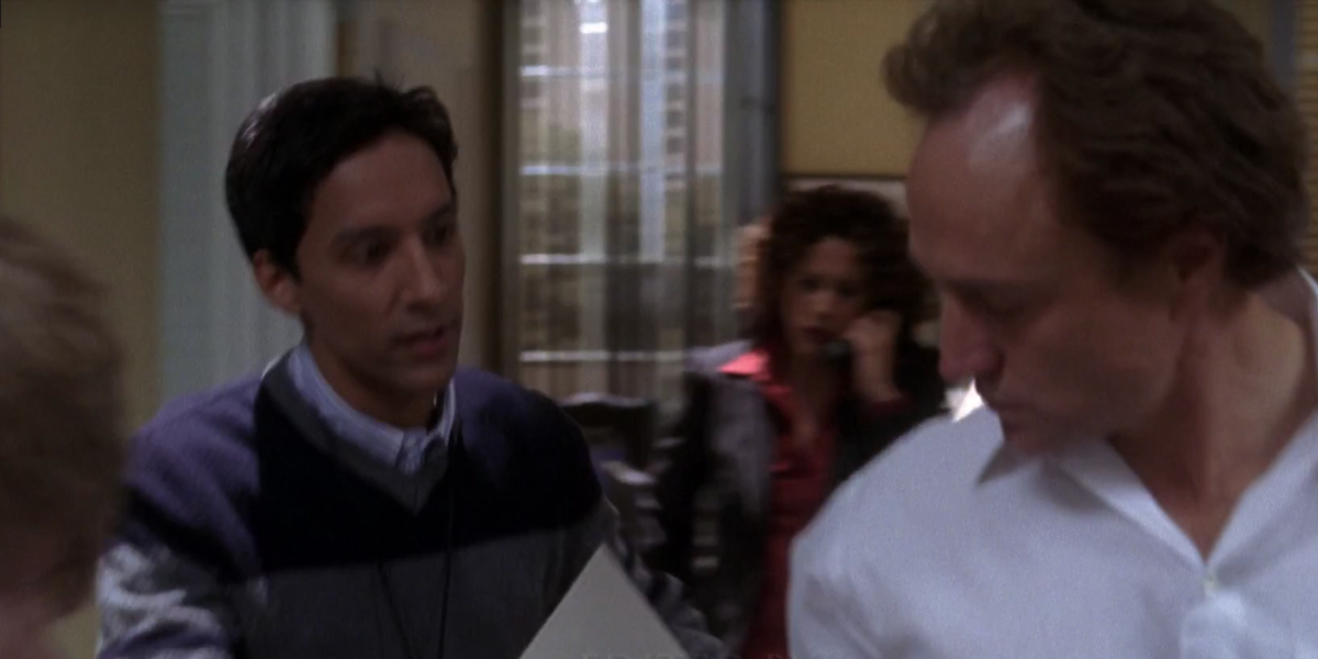 The West Wing Danny Pudi Santos Aide hands paper to Josh Lyman
