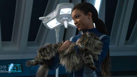 Michael (Sonequa Martin-Green) holding Book's big chonky cat in 'Star Trek: Discovery'.