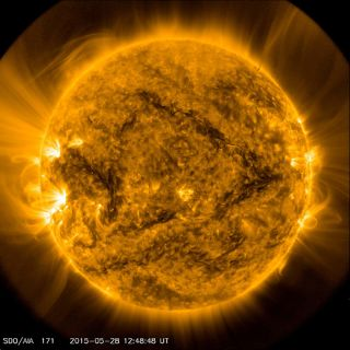 """A """"seesaw"""" filament emerged over the sun's surface in this photo taken by NASA's Solar Dynamics Observatory on May 28, 2015."""