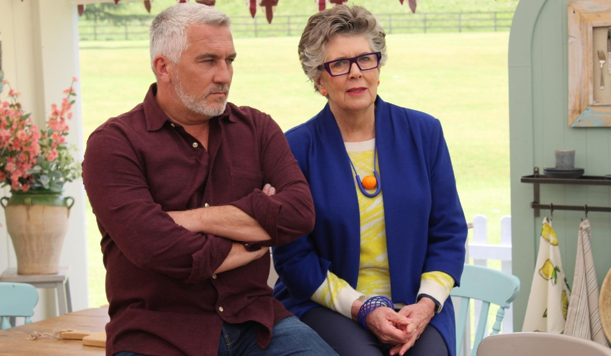 Great British Baking Show Paul and Prue sitting in the tent