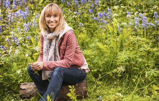 Michael Strachan, one of the presenters of Springwatch, sits with spring flowers in the background