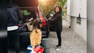 A family unloads their electric car