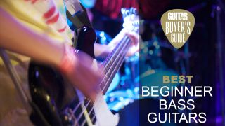 Person plays bass guitar live on stage