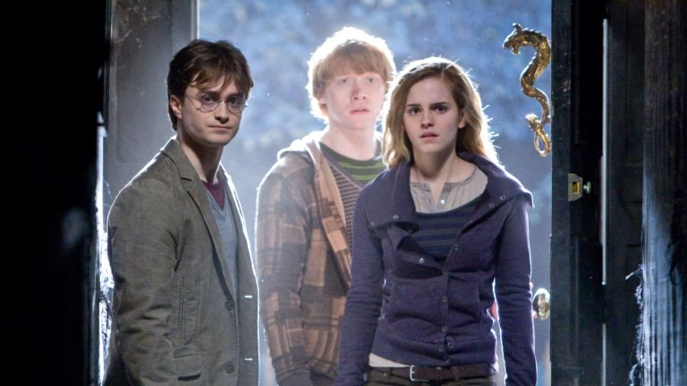 DANIEL RADCLIFFE as Harry Potter, RUPERT GRINT as Ron Weasley and EMMA WATSON as Hermione Granger in Warner Bros. PicturesÕ fantasy adventure ÒHARRY POTTER AND THE DEATHLY HALLOWS Ð PART 1,Ó a Warner Bros. Pictures release