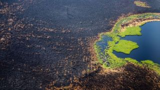 This aerial picture taken on July 27, 2021, shows a burned forest at Gorny Ulus, west of Yakutsk, in Siberia.