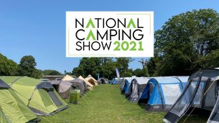 Tents in a field with National Camping Show logo