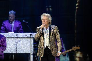 Rod Stewart in glittery gold jacket