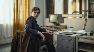Martin Rauch (Jonas Nay) sits at a 1980s-style computer in Deutschland 89