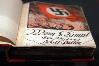 """Mein Kampf"" (My Struggle) by Adolf Hitler is shown during a press preview of the exhibition ""Hitler and the Germans Nation and Crime"" at the German Historical Museum on Oct. 13, 2010, in Berlin."