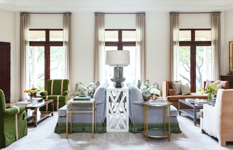 An example of how to design a living room with symmetrical back to back sofas green and blue sofas.