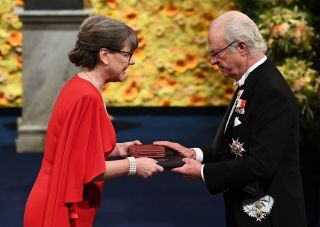 Co-laureate of the 2018 Nobel Prize in Physics French physicist, Canadian physicist Donna Strickland receives her Nobel Prize from King Carl XVI Gustaf of Sweden. She is the third woman ever to win a Nobel in physics.