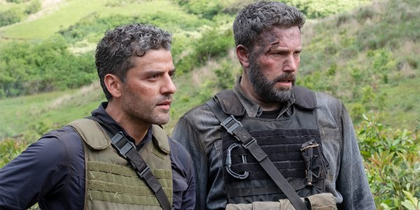 Triple Frontier Oscar Isaac and Ben Affleck surveying a situation in the jungle intensely