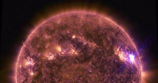 Still from NASA's Solar Dynamics Observatory video of solar flares