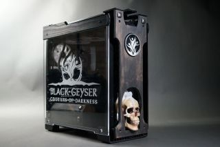 A gaming PC in a black case with a modeled human skull on the front.