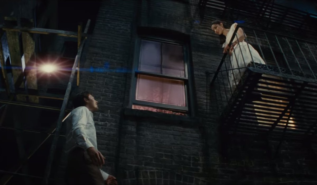 Tony and Maria stand on their balconies in West Side Story.
