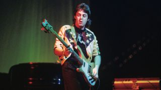 Paul McCartney performs live on stage with Wings at Ahoy on 25th March 1976 in Rotterdam, Netherlands. He plays a Rickenbacker 4001S bass guitar.