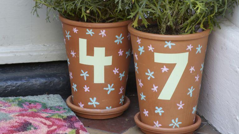 Quirky house number pots. Terracotta pots with bright hand painted house numbers