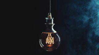 A lightbulb hanging in a dark room