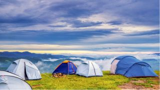 A field filled with camping tents