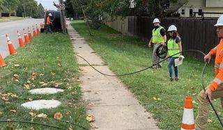 Technicians deploy Google Fiber in West Des Moines, Iowa