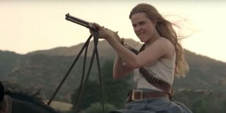 Dolores shooting and riding a horse