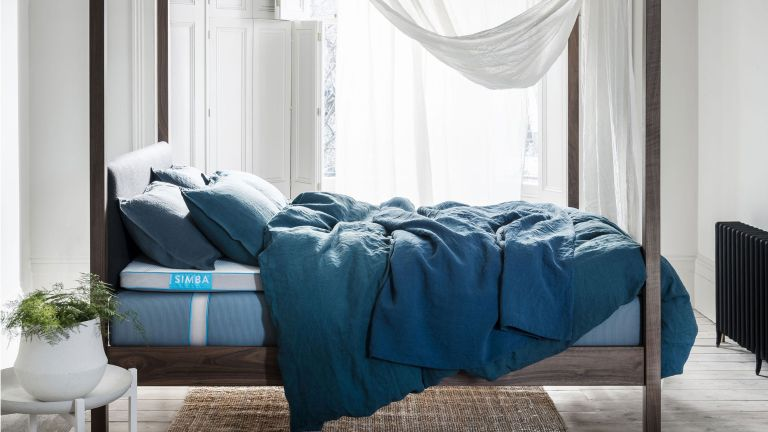 Simba mattress discount code: bed with simba mattress and dark wood frame and blue bedding