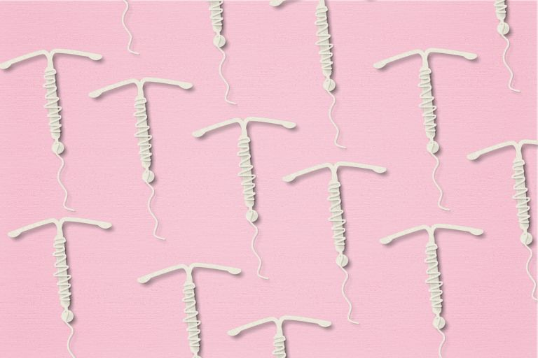 multiple IUDs in rows on a pink background