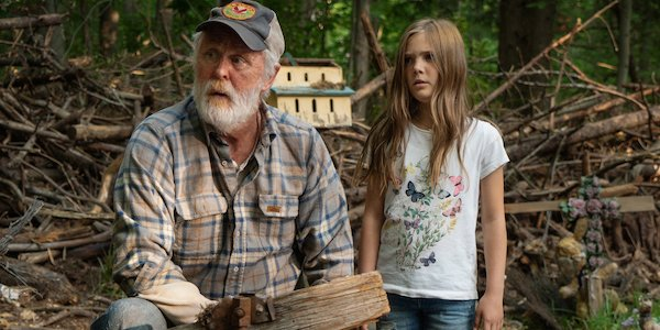 John Lithgow as Judd Crandle, and Jeté Laurence as Ellie Creed in Pet Sematary