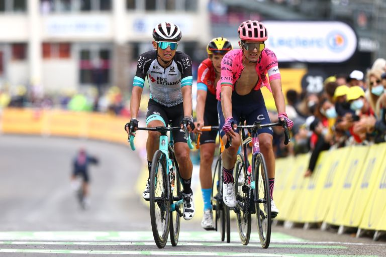 Esteban Chaves finishing stage 18 of the 2021 Tour de France alongside Ruben Guerreiro and Dylan Teuns